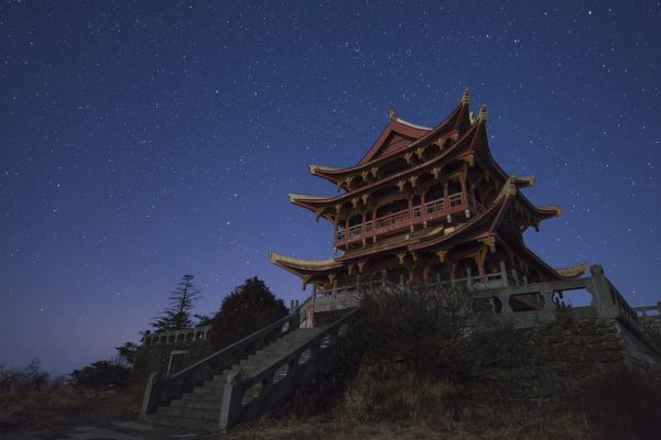 Northern stars of the Big Dipper and constellation Leo shine above the Wanfo Summit at the World Heritage site of Mount Emei in China