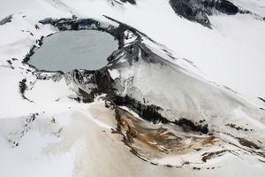 Aerial view of snow-covered Ruapehu volcano summit crater with acidic lake, New Zealand