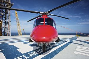 AgustaWestland AW109E utility helicopter on the helipad of an oil rig