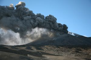 Ash clouds erupting from crater during eruption of Mount Etna volcano, Sicily, Italy