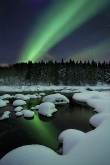 Aurora Borealis over Tennevik River in Troms County, Norway