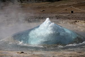 Bursting water bubble at onset of eruption of Strokkur Geysir, Iceland