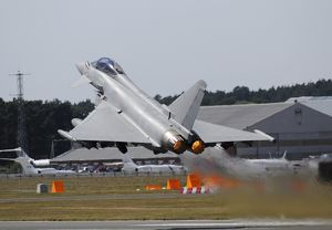 Eurofighter EF2000 Typhoon from the Royal Air Force at full afterburner during takeoff