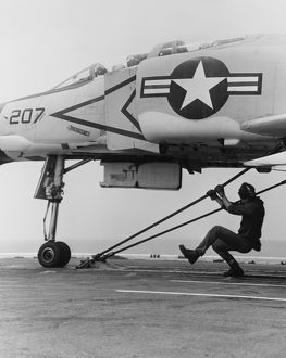 An F-4B Phantom II fighter plane is readied for launch from USS Coral Sea, 1969