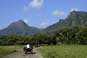 A group of ATV quad riders take to the trail near Ko'olau Range in Oahu, Hawaii