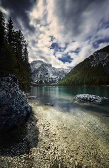 Lake Braies and Dolomite Alps against stormy clouds, Northern Italy