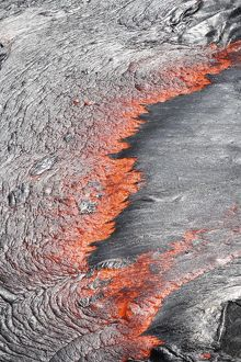 Lava flowing from under crust of lava lake, Erta Ale volcano, Danakil Depression