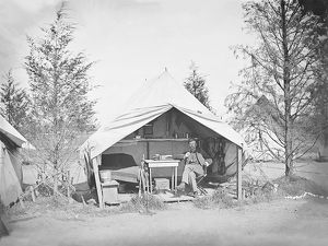 Lieutenant James B. Neill sitting inside his tent during the American Civil War