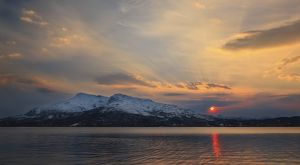 Midnight Sun over Tjeldsundet strait in Troms County, Norway