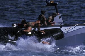 Navy SEALs practice high speed boat cast and recovery