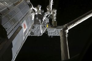 The robotic arm of the Japanese Experiment Module assists in installing components