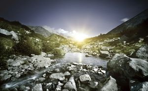 Small river flowing over large stones at sunset, Pirin National Park, Bulgaria