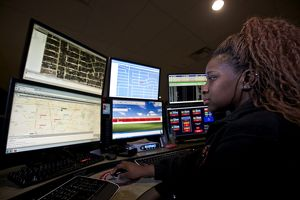 Young woman working in the emergency service dispatch control room